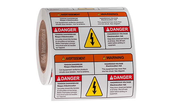 A roll of pre-printed electrical safety labels, warning of a potential electrical hazard, in both English and French, with color symbols.