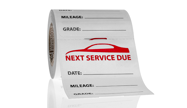 A clear service label with lines to indicate the date, mileage of the car, and grade that can be applied to windshields using static-cling.